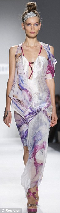 A model presents a creation at the Katya Leonovich Spring/Summer 2013 collection