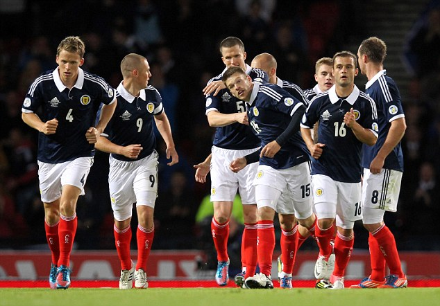 Come on: Scotland players celebrate their equaliser