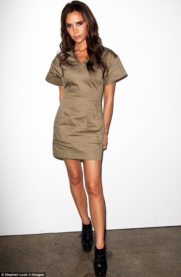 Keeping it simple: Victoria wore a khaki dress from her own collection, teamed with a pair of sky-high heels