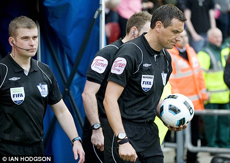 Man in the middle: Andre Marriner will take charge of QPR's game with Chelsea