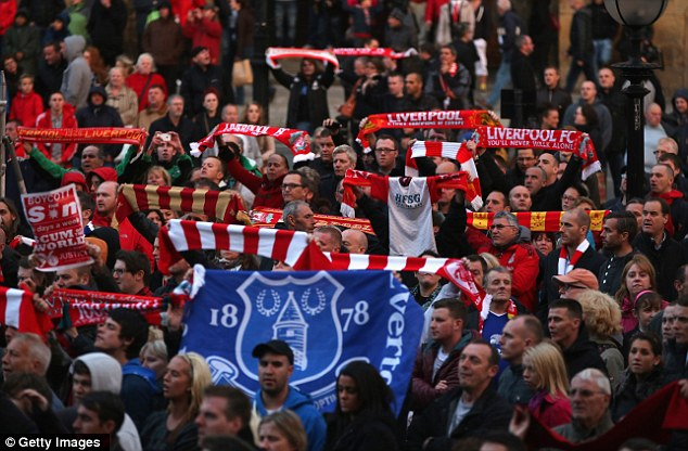 "United in emotion: Fans of both Liverpool and Everton gathered in the city and sang ""You'll Never Walk Alone"""