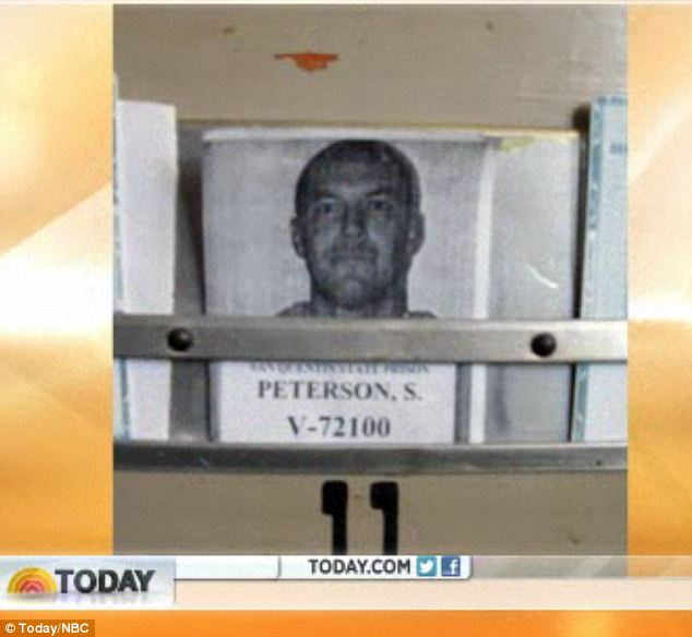 Up close: The door to Peterson's cell, which he lives in alone, bears his picture and prisoner number
