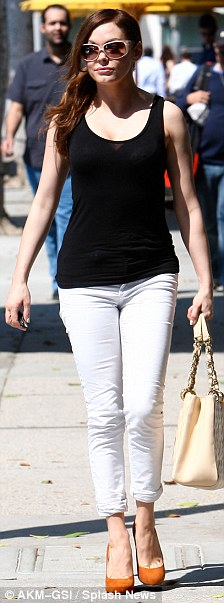 Monochrome: Letting her trousers do most of the talking, the Charmed actress went for a monochrome look by paring them with a basic black tank top