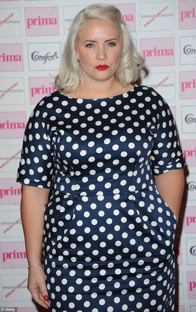 Smile! Claire Richards arrives at the Prima High Street Fashion Awards wearing an unflattering polka dot dress