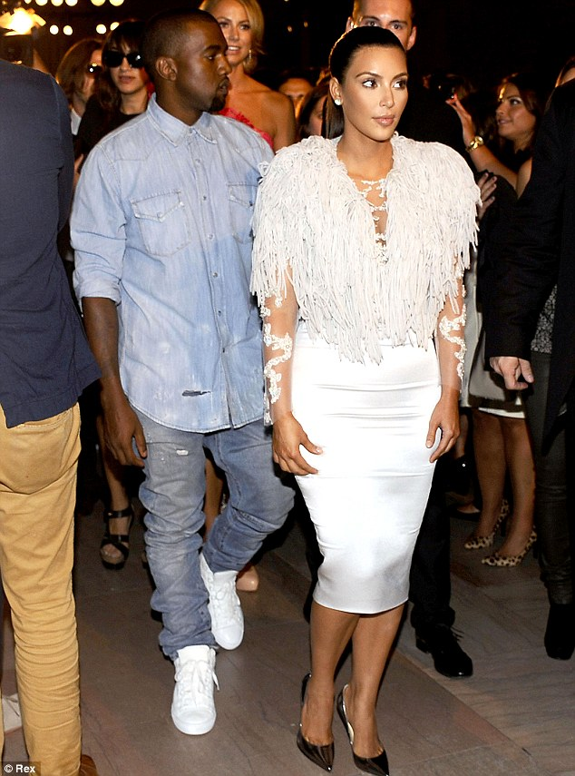 Cheer up! Kim and Kanye both looked quite downcast as they made their way into the fashion show