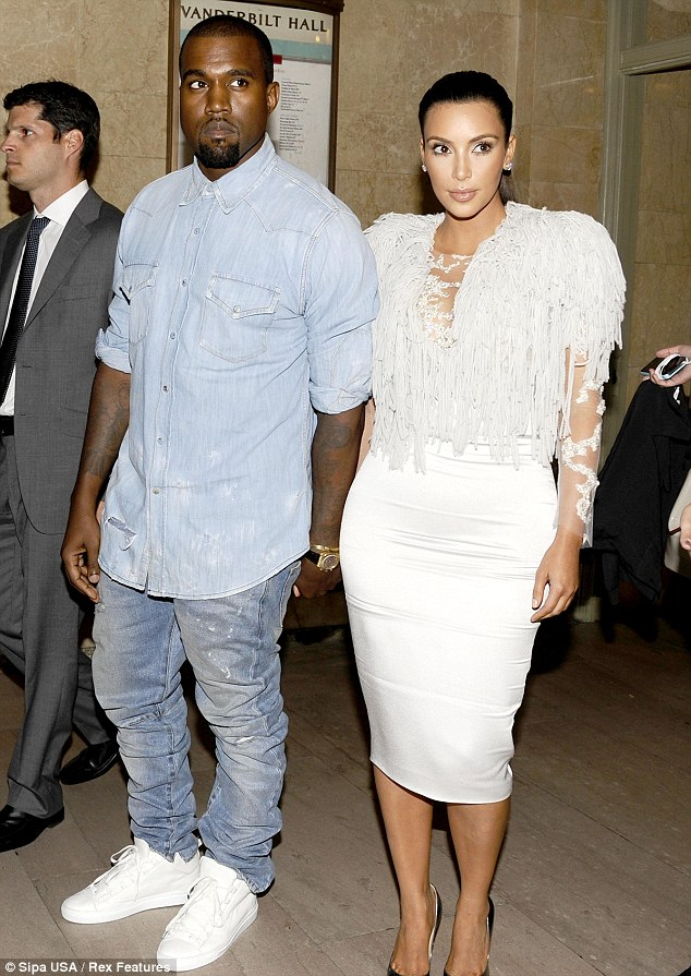 Fashion fans:  Kanye West and Kim Kardashian hold hands as they arrive for the Marchesa show during New York Fashion Week