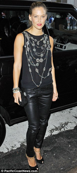 Low ley:  Bar Refaeli didn't bother with the high wattage glamour favoured by Marchesa and opted for a rock chick look in a sleeveless T-shirt and leather trousers