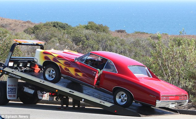 Towed: The actor's hot rod was taken away on the back of a truck