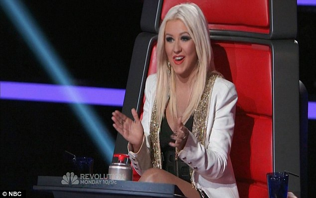 Blonde ambition: Christina won the Nigerian-born singer's favour after turning her chair around first