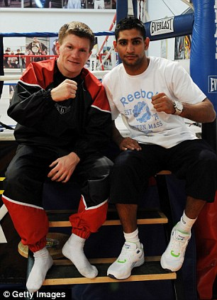 Close friends: Hatton (left) with Khan
