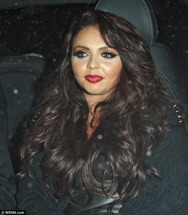Glamour puss: Jesy left her long brunette hair loose in tumbling curls for the night out
