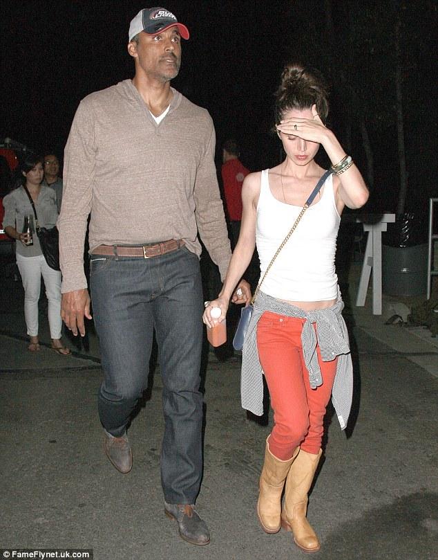 Music fans: Eliza Dushku and boyfriend Rick Fox