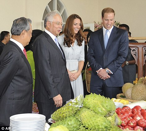 Earlier in the day, William and Kate found themselves confronted with a huge platter of local fruits during a luncheon in Putrajaya, Malaysia