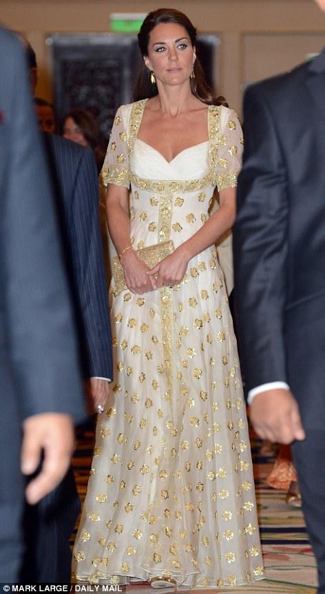 Glittering: Kate's golden gown shimmers as she arrives at the lavish dinner