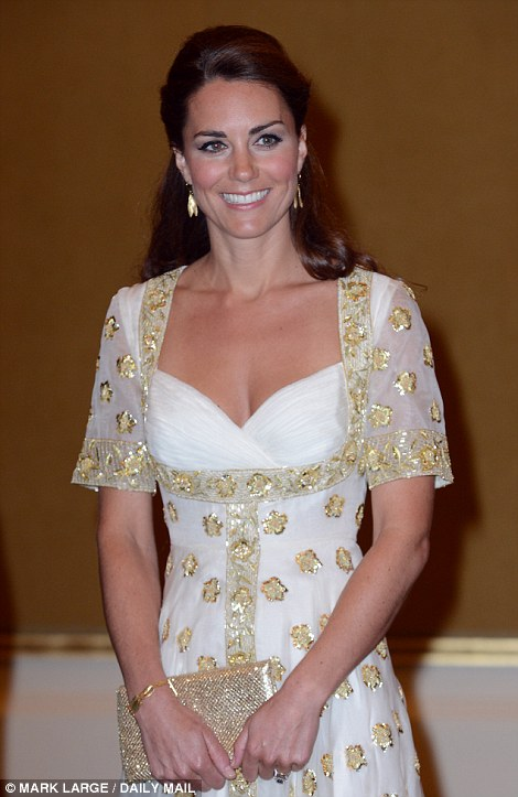 When the King and Queen arrived, Kate elegantly offered each of them a low curtsey. William proceeded to chat with the King while Kate stooped as she exchanged pleasantries with his wife