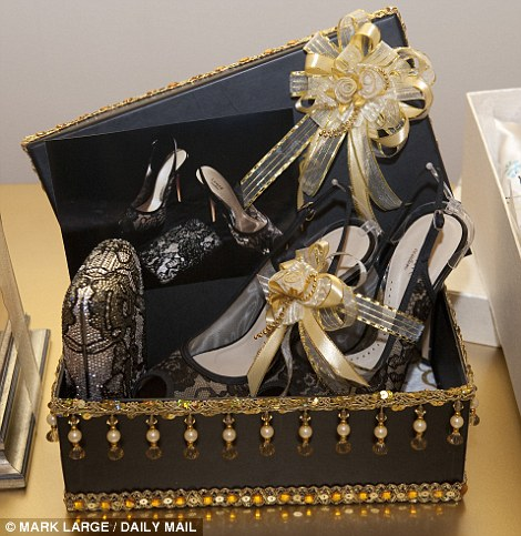 For Kate there was a pair of black lace peep toe shoes by the Malaysian equivalent of Jimmy Choo called Lewre with a glittering diamante clutch bag and a Batik dress