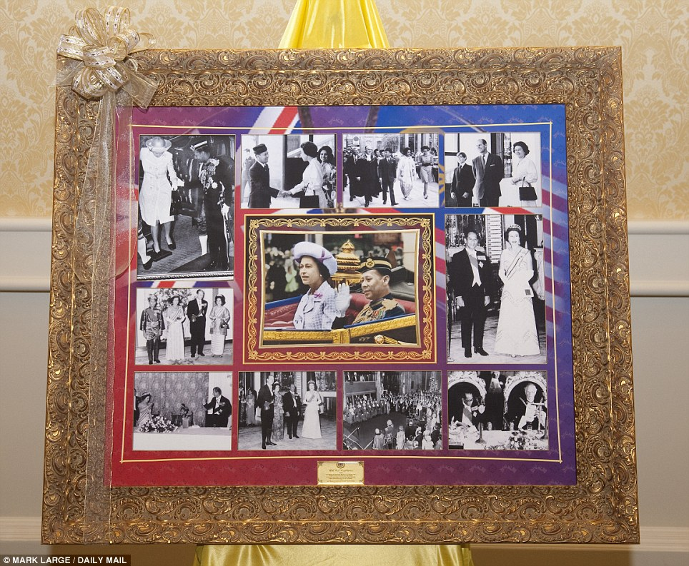 Pictorial tribute: Britain's own Monarch was also honoured in a series of photographs which highlighted the friendship between the Queen and Malaysia's King