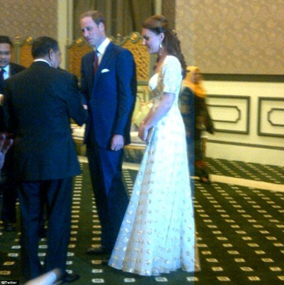 Meet and greet: Prince William shakes hands with a dignitary as he and his wife prepare for the lavish event