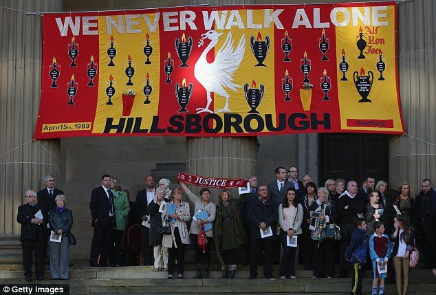 Relatives and friends of the the victims of the Hillsborough disaster take part in a vigil outside Liverpool's St George's Hall on Wednesday