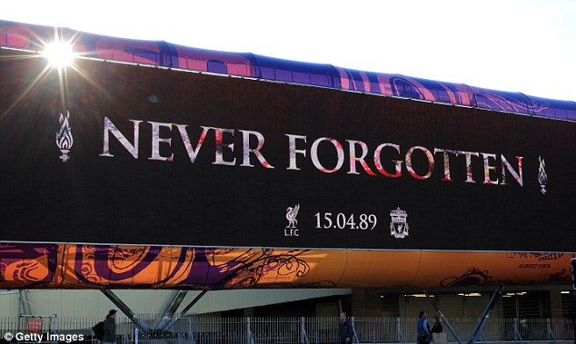 A message of condolence is displayed in Liverpool City Centre