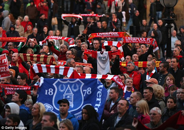 Support: Everton fans joined Liverpool supporters in Wednesday's vigil to the victims of the Hillsborough disaster in Merseyside on Wednesday