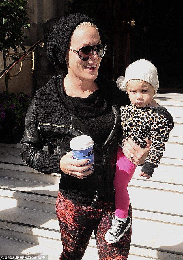 Doting mummy: Pink was pictured today (Thursday) in London leaving her hotel with her daughter Willow