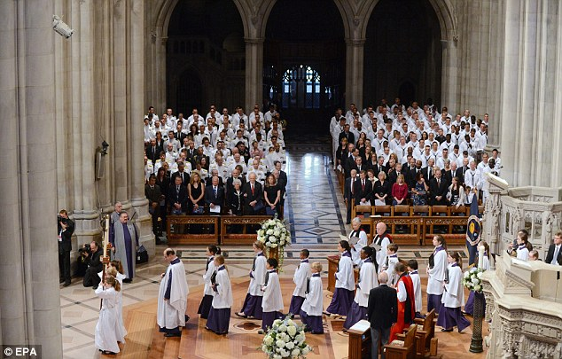 The procession leaves the crossing in the nave at the conclusion of the memorial service for Neil Armstrong, at the Washington National Cathedral in Washington DC