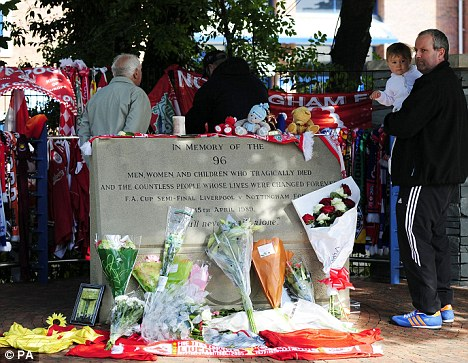 Mourning: Liverpool fans are coming to terms with the huge injustice handed out to their fans at Hillsborough 23 years ago