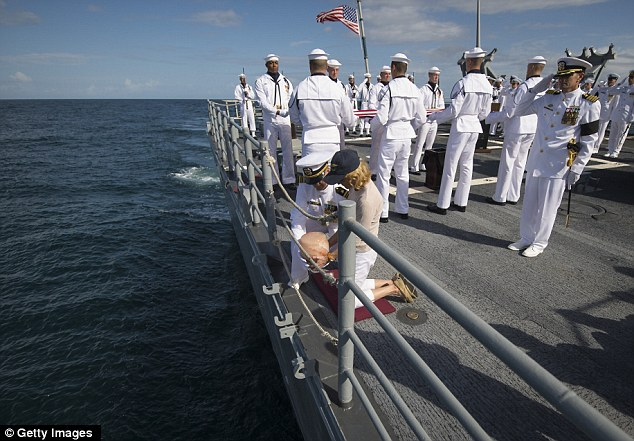Final farewell: U.S. Navy Lieutenant Commander Paul Nagy and Armstrong's wife Carol, commit the remains of Neil Armstrong to sea
