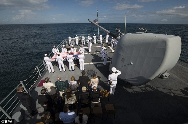 Laid to rest: Family members of Armstrong and members of the US Navy are seen during the burial at sea service; the location of his burial was not immediately clear