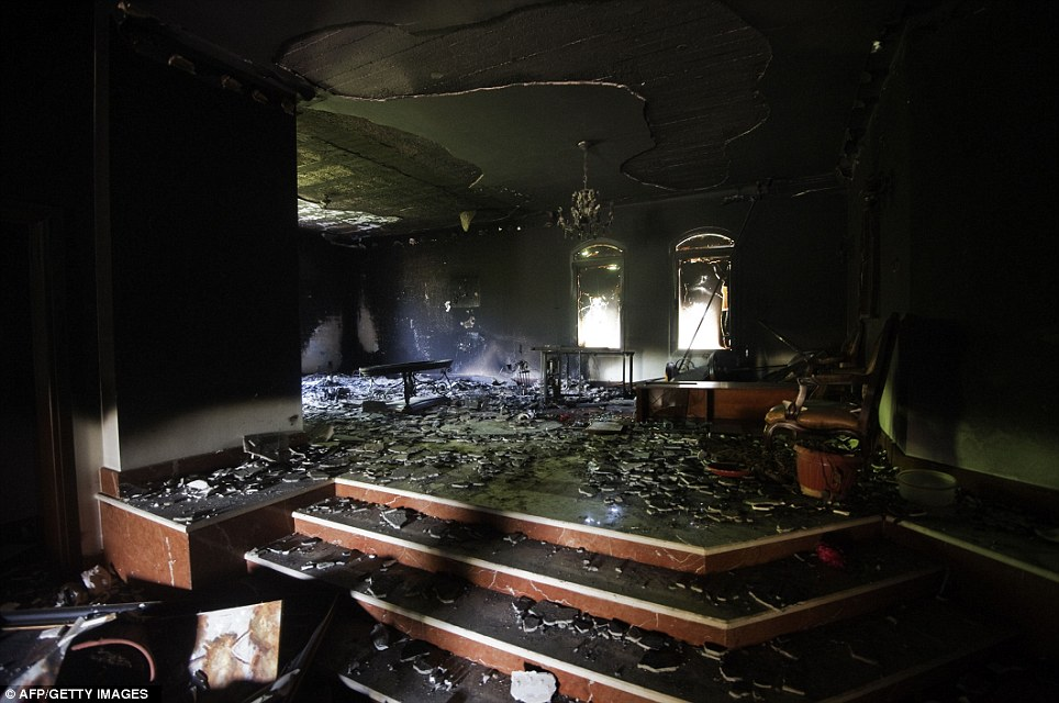 Cracked: A picture shows damage inside the burnt US consulate building in Benghazi on Wednesday, with much of the roof plaster fallen and the windows blown out