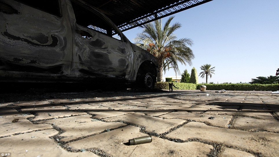 Hints of violence: An empty bullet casing is seen on the ground near one of the burnt-out cars of the U.S. Consulate