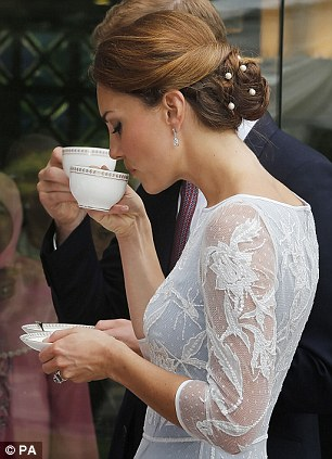 Nice cuppa: The Duchess of Cambridge sips a cup of tea during a Diamond Jubilee Tea Party at the British High Commission in Kuala Lumpur