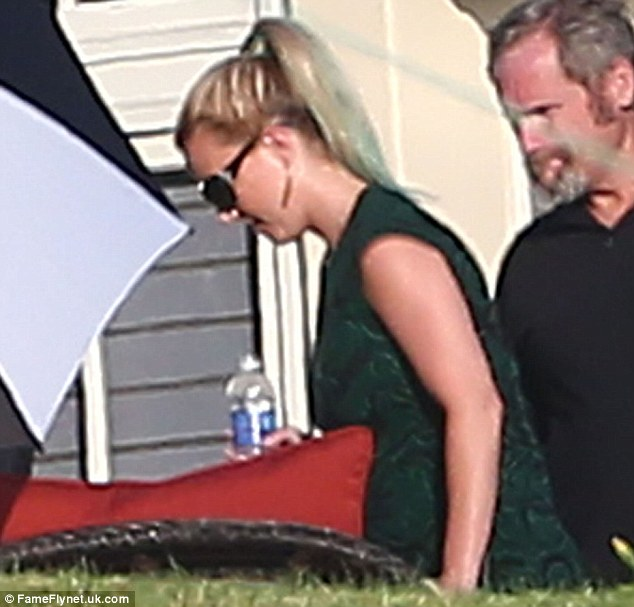 simple yet stylish: Britney was seen in a green sleeveless dress with her hair tied in a ponytail