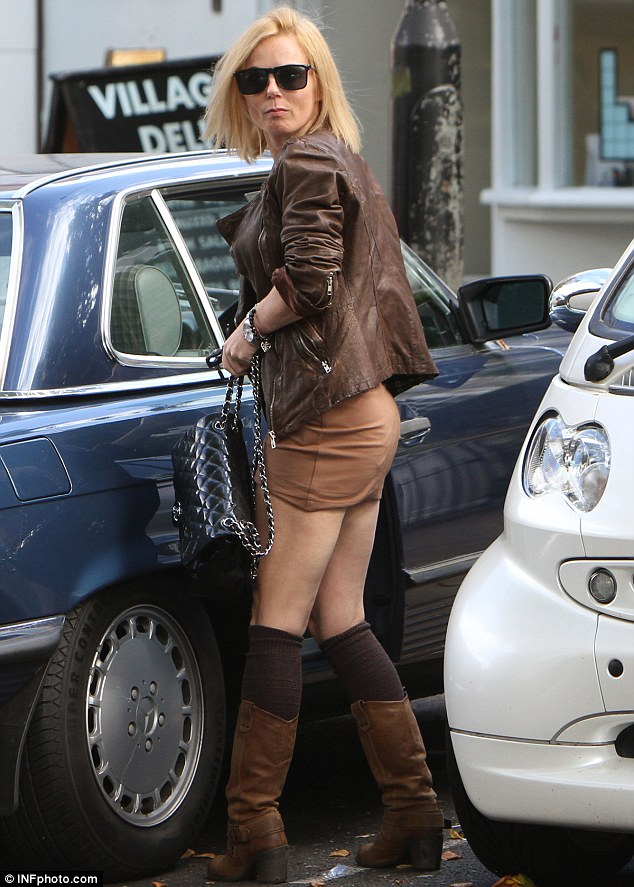 Short stuff: Geri Halliwell runs errands in North London on the school run in a very short brown dress