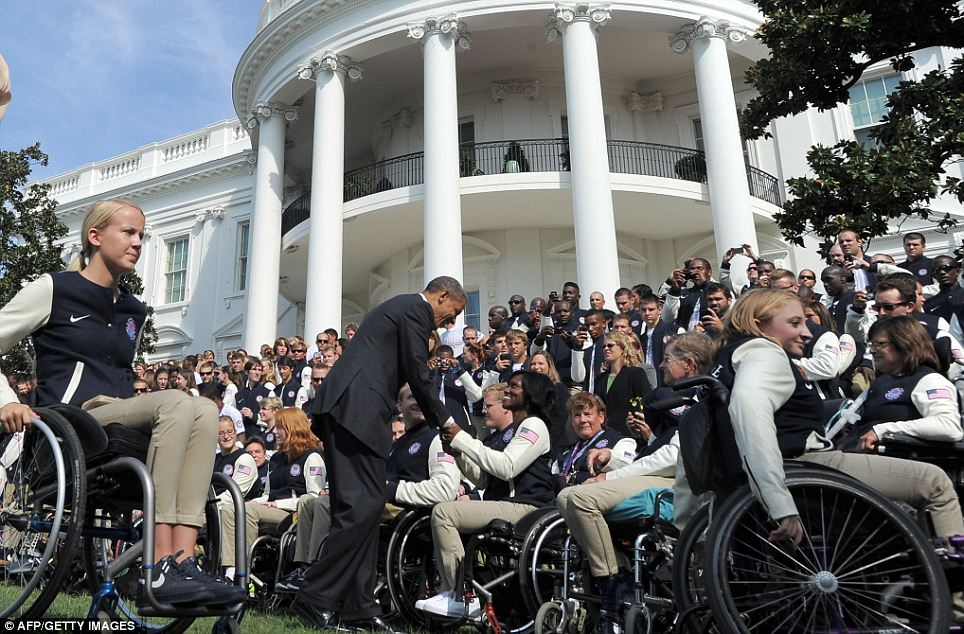 Popular: Athletes gaze up in awe at the President, as he congratulates them and shakes their hands
