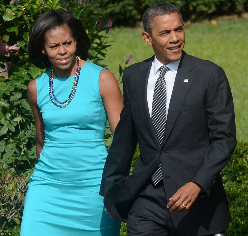 Fashionably late: Mr and Mrs Obama stroll up to the South Lawn to begin the festivities