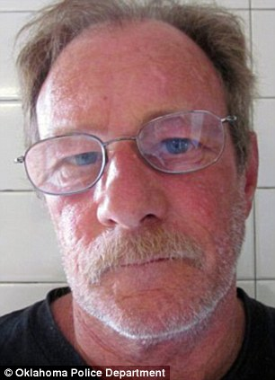 Nabbed: Michael Brewster, 54, of Pensacola, Fla. was arrested on Thursday after pulled over for running a stop sign in Oklahoma in what they'd discovered was a stolen SUV