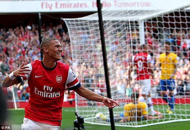 In a heap: Kieran Gibbs takes the plaudits after Jos Hooiveld is slumped in his own net after scoring the opener