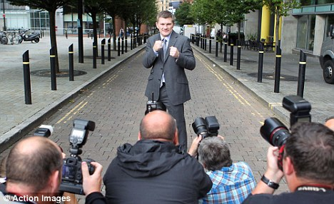 Ricky 'Hitman' Hatton poses for photographers at a press conferenc