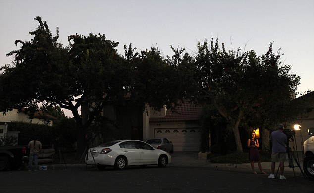 A TV reporter is pictured outside the home of Nakoula Basseley Nakoula in Cerritos