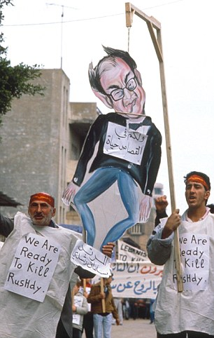 Death threat: Demonstrators in Beirut issue a chilling message to Rushdie