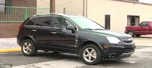 In a hurry: Brewster was arrested in Oklahoma on Thursday after driving this stolen SUV from Florida through a stop sign