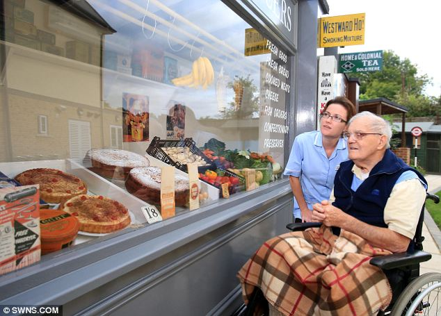 Far cry from our Tescopoly: Mr Lloyd peers into the window of the greengrocers