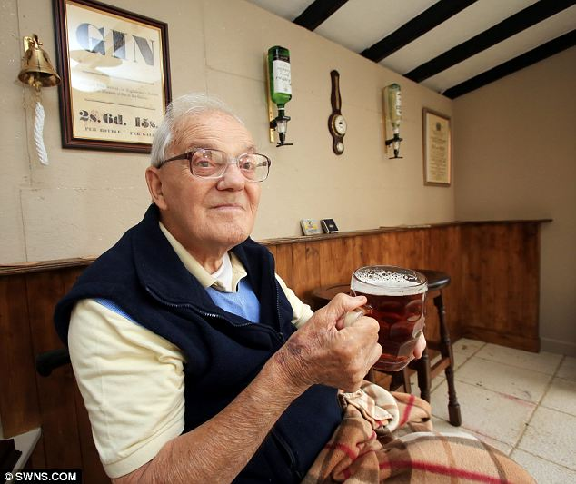 Try asking for a mug of ale like that at Wetherspoon's: Mr Lloyd enjoys a pint in the Fifties pub