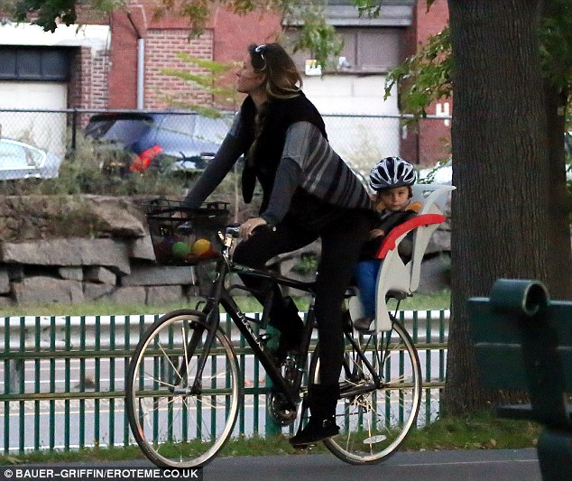 Biking in Beantown: Her 2½ year-old son with NFL quarterback Tom Brady was safely strapped into the back of Gisele's bicycle-built-for-two