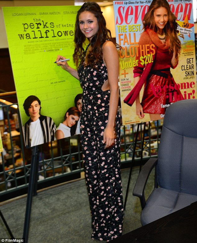 Smiling star: Nina Dobrev attended an autograph signing at Barnes and Noble in Atlanta, Georgia on Saturday wearing a lovely floral pantsuit