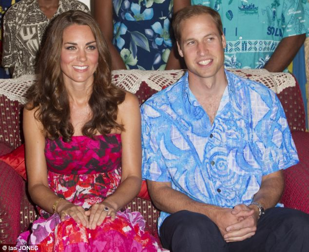 Dressed up: Kate was said to love the strapless dress with pink and orange batik design