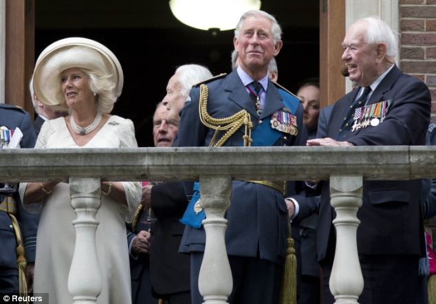 Thanksgiving: Charles and Camilla watched the flypast with Wing Commander Bob Foster