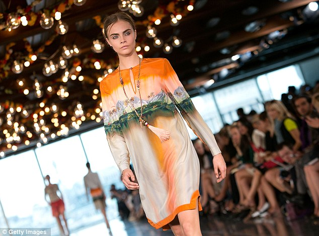Inspired: Cara Delevingne wore a silk dress printed with a stylised scene from Kerala taken by Matthew Williamson